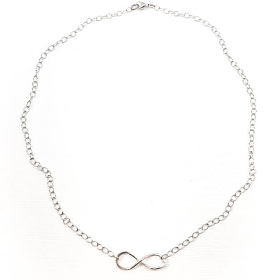 flat lay view of sterling silver Infinity Maggie Necklace by Judie Raiford