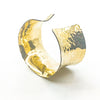 side angle view of 14k Gold Filled Ball Pein Anticlastic Cuff by Judie Raiford