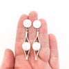 Sterling silver Split Earrings with White Coin Pearl by Judie Raiford held in hand