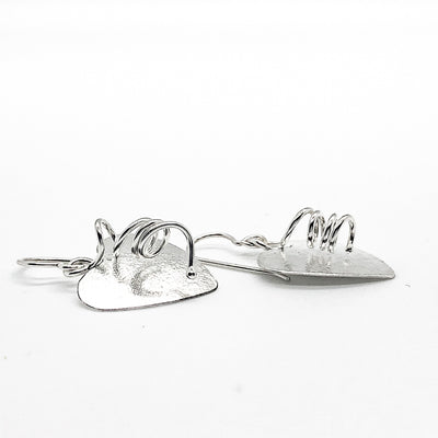 side angle view of Sterling Silver Curly Heart Earrings by Judie Raiford