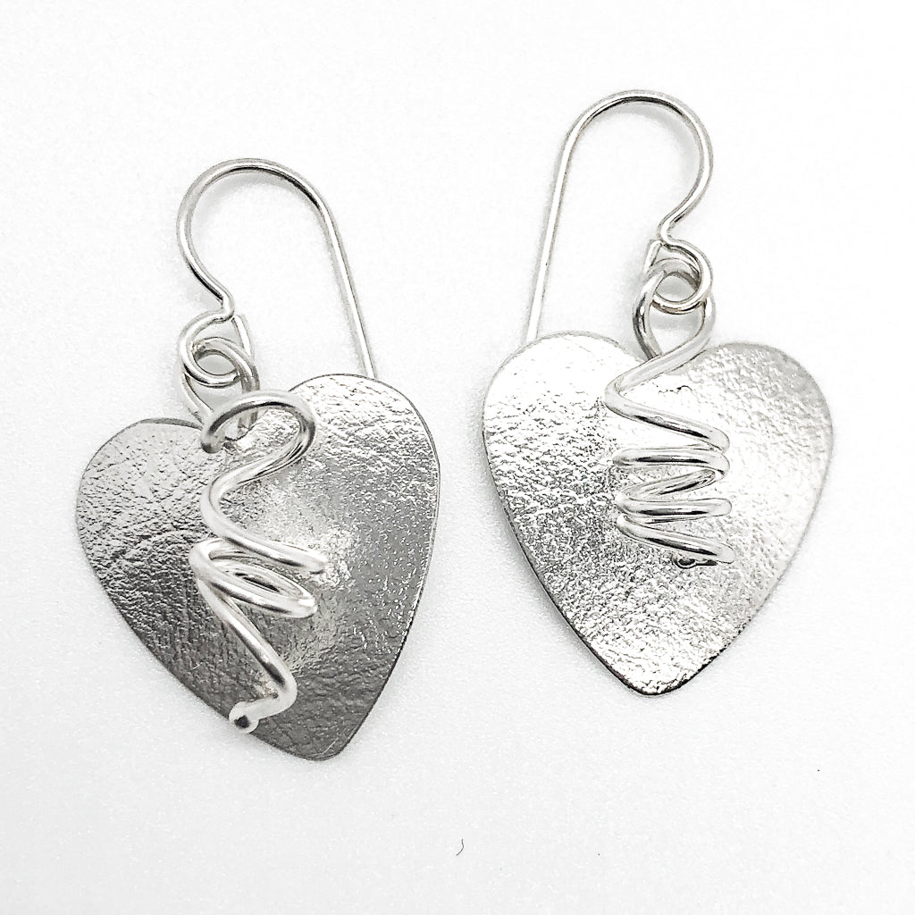 flat lay view of Sterling Silver Curly Heart Earrings by Judie Raiford