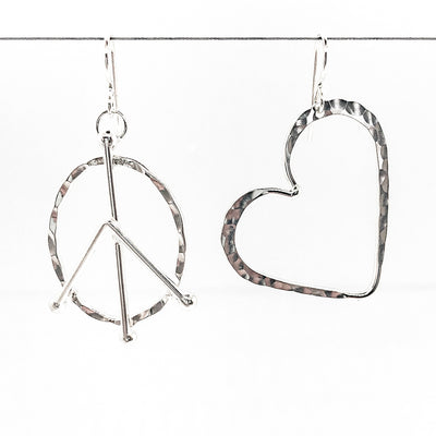 sterling silver Peace and Love Earrings by Judie Raiford hanging on wire