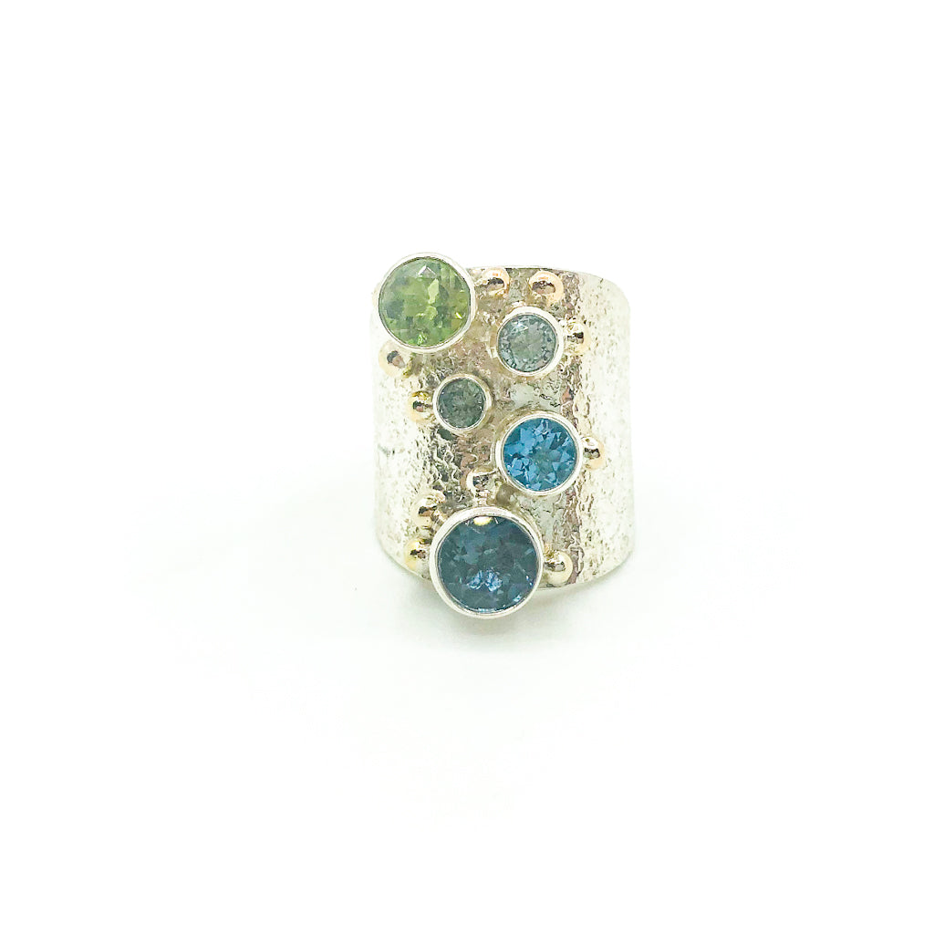 size 8.25 Brenda Big Girl Ring with sterling silver, 14k gold, 8mm London blue topaz, 7mm peridot, 6mm swiss blue topaz, 5.5 mm aquamarine, 4mm Montana sapphire  by Judie Raiford