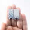 Bubble Up Earrings with Garnet by Judie Raiford held in hand