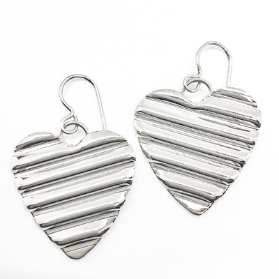 flat lay view of Large Sterling Silver Corrugated Heart Earrings by Judie Raiford