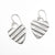 flat lay view of Small Sterling Silver Corrugated Heart Earrings by Judie Raiford