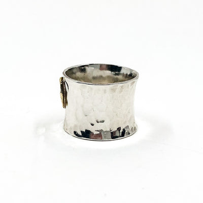left side view of size 6.75 Anticlastic Dot Ring with Blue Sapphire by Judie Raiford