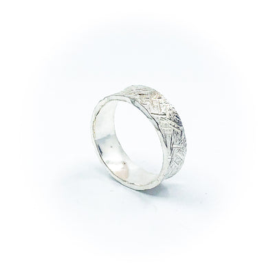 side angle view of size 11.25 Men's Sterling Mom's Hammer Cross Hatch Textured Ring by Judie Raiford