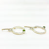 side angle view of Sterling Pluto Earrings with Peridot by Judie Raiford