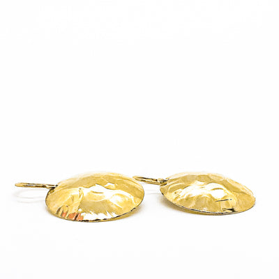 side angle flat lay of 14k Gold Filled Domed Ball Pein Earrings by Judie Raiford