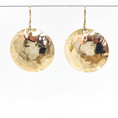 14k Gold Filled Domed Ball Pein Earrings by Judie Raiford hanging on a wire