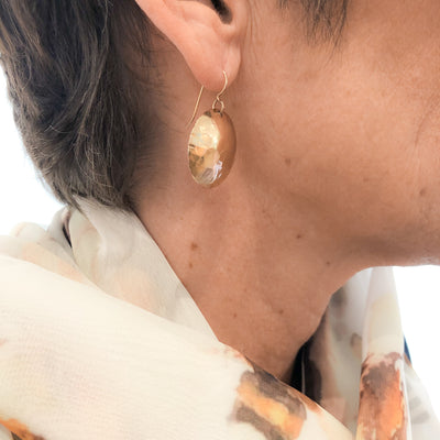 14k Gold Filled Domed Ball Pein Earrings by Judie Raiford worn on a model