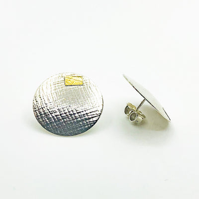 side angle view of Sterling and 24k Textured Dome Earrings by Judie Raiford