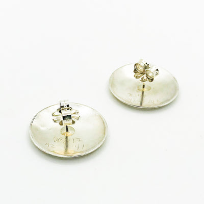 side angle bottom view of Sterling and 24k Textured Dome Earrings by Judie Raiford
