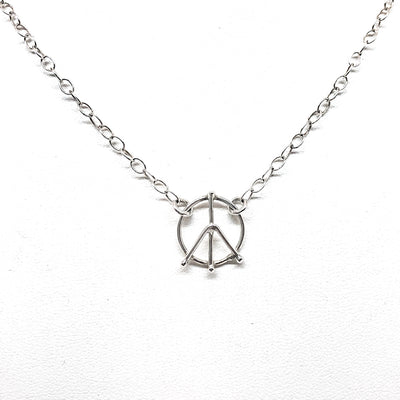 detail view of peace sign pendant in sterling silver Tiny Peace Sign Necklace by Judie Raiford