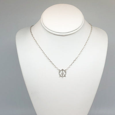 sterling silver Tiny Peace Sign Necklace by Judie Raiford on mannequin