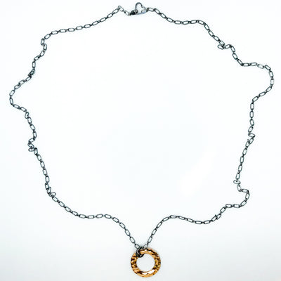 flat lay of Oxidized Sterling & 14k Gold Filled Ball Pein Circle Necklace by Judie Raiford