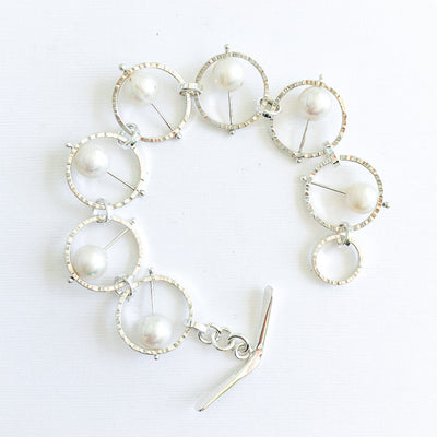Flat Lay view of Not Naught Round Sterling Bracelet with White Pearls by Judie Raiford