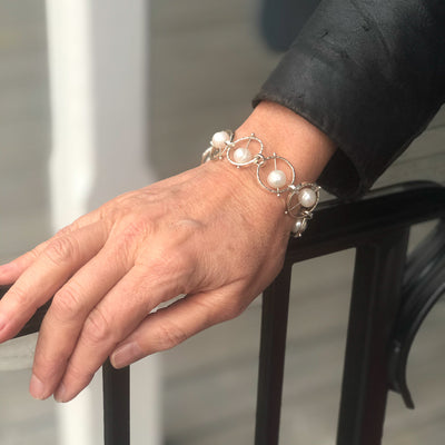 lifestyle view of Not Naught Round Sterling Bracelet with Pearls by Judie Raiford