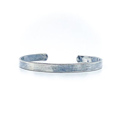 Oxidized Sterling Flat Band Cuff with Paw Print by Judie Raiford