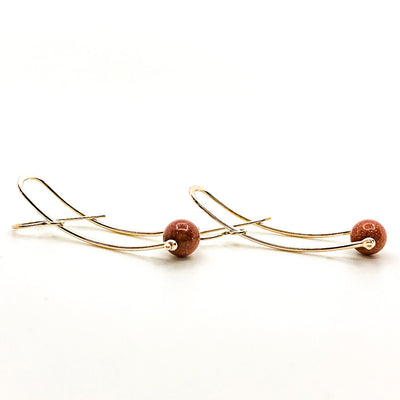 side view of Long Brewish Earrings with Goldstone by Judie Raiford