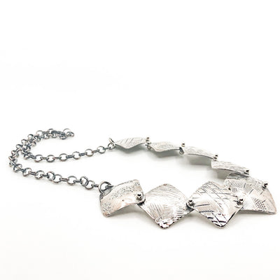 side angle view of Oxidized Sterling Traveling Squares Necklace by Judie Raiford