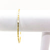 14k Gold Filled Bubble Texture Bangle by Judie Raiford hanging on white bracelet display stand