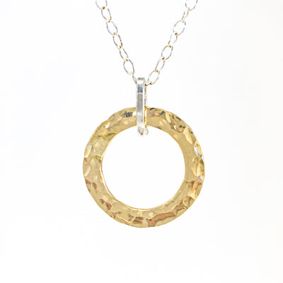 detail of pendant view of Sterling and 14k Gold Filled Ball Pein Hammered Circle Pendant Necklace by Judie Raiford