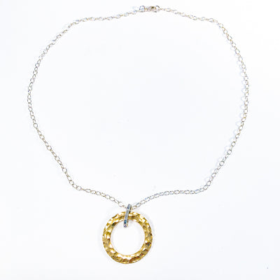 flat lay view of Sterling and 14k Gold Filled Ball Pein Hammered Circle Pendant Necklace by Judie Raiford
