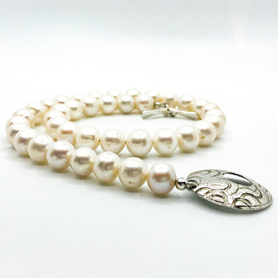side angle view of Sterling Cupcake Necklace with White Baroque Pearls by Judie Raiford