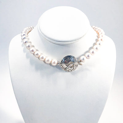 Sterling Cupcake Necklace with White Baroque Pearls by Judie Raiford displayed on white mannequin bust