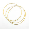 over top view of 14k Gold Filled Skinny 3-Piece Bangle Set by Judie Raiford