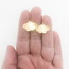 14k Gold Filled Mini Ginkgo Earrings by Judie Raiford held in hand