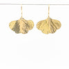 14k Gold Filled Mini Ginkgo Earrings by Judie Raiford hanging on a wire