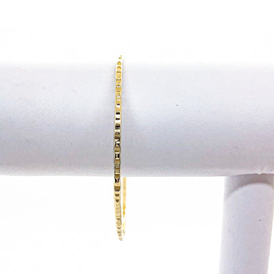 14k Gold Filled Cross Pein Bangle by Judie Raiford on white bracelet display stand