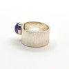 left side view of size 6.5 Sterling Cross Pein Hammered Ring with Amethyst by Judie Raiford