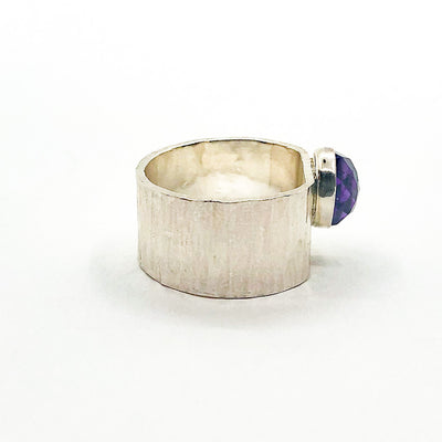 right side view of size 6.5 Sterling Cross Pein Hammered Ring with Amethyst by Judie Raiford