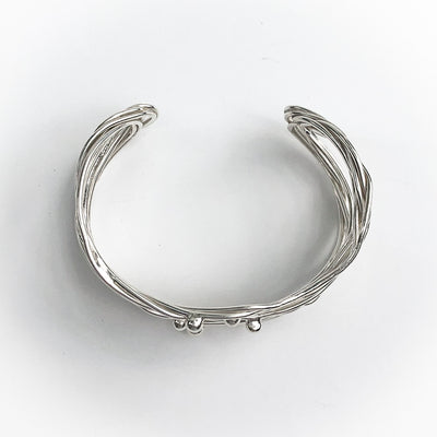 overhead view of Sterling Random Theory Bracelet by Judie Raiford