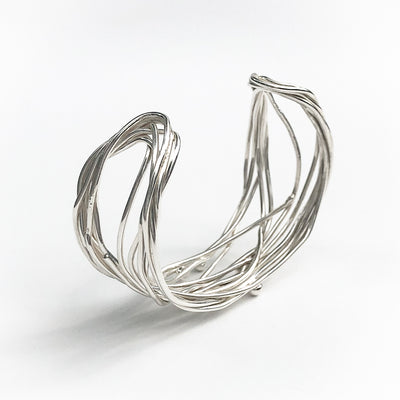 angle view of Sterling Random Theory Bracelet by Judie Raiford