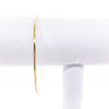 14k Gold Filled Bangle by Judie Raiford hanging on white bracelet display stand