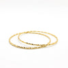 pair of 14k Gold Filled Single Twist Bangle by Judie Raiford