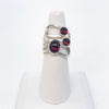 Sterling Wrap Ring with 3 Garnet Cabochons by Judie Raiford on white finger display stand