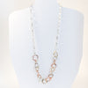 long version on mannequin of Five Metal Necklace by Judie Raiford