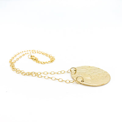 side angle view of 14k Gold Filled Ball Pein Flat Disc Lynne Necklace by Judie Raiford