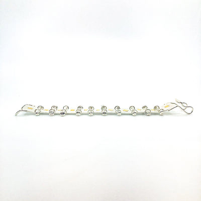 side angle view of Sterling and 22k Singer Bracelet by Judie Raiford