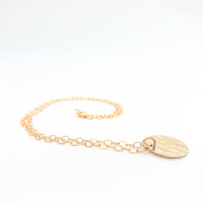 side angle view of 14k Gold Filled Ball Pein Mini Flat Circle Disc Necklace by Judie Raiford