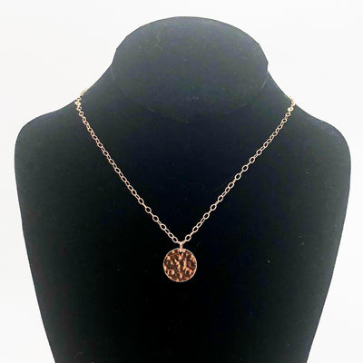 14k Gold Filled Ball Pein Mini Flat Circle Disc Necklace by Judie Raiford hanging on mannequin bust