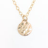detail view of 14k Gold Filled Ball Pein Mini Flat Circle Disc Necklace by Judie Raiford