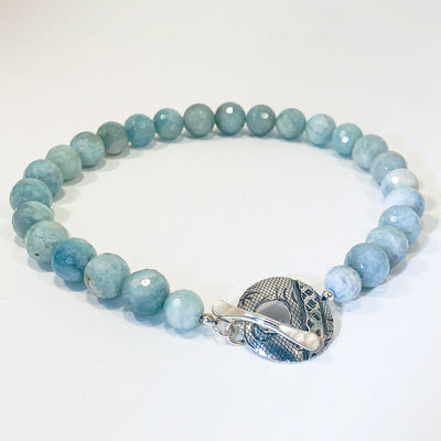 side angle view of Faceted Aquamarine Beads with Sterling Cupcake Clasp by Judie Raiford