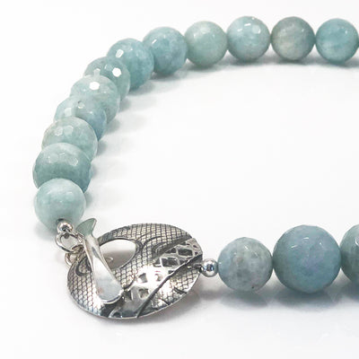 detail view of Faceted Aquamarine Beads with Sterling Cupcake Clasp by Judie Raiford
